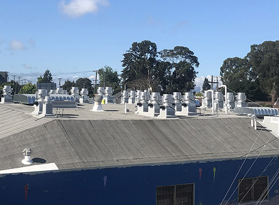 Neighbors' rooms with a view of CK's rooftop exhaust units.